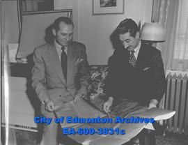 Architect A. Gordon Lorimer (right) with architectural drawings.