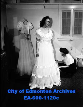 Dorothy Christmas tries on wedding gown.