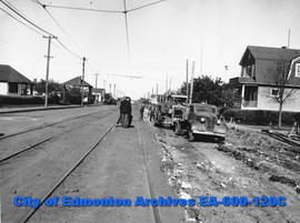Equipment preparing 107 Avenue for paving and conversion from streetcars to trolley buses, Edmonton.