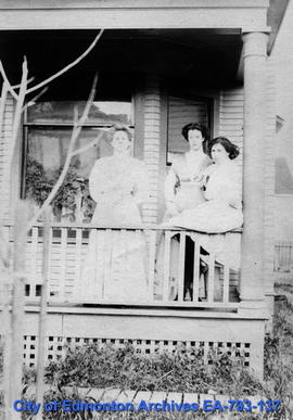 Three women on a porch