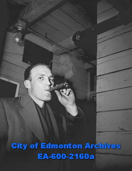 Hockey - Flyers defeat Calgary Stampeders: Elmer Kreller smoking cigar.