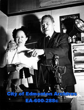 Mrs. Violet Chang Lowe of Shanghai, China weighs some drugs on a Chinese scale while in Edmonton ...
