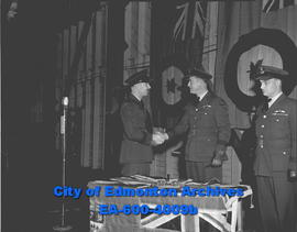 Change of command at NWAC. Wing Commmander A.W. Speed (left) shakes hands with his predecessor, W...