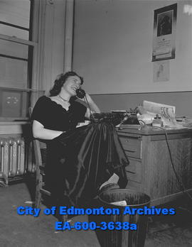 Stenographer feature: secretary talking on the phone.