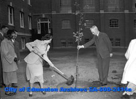 June Sigworth and Dr. Robert Newton plant a tree on University Campus.