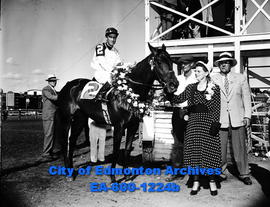 Betjin, with Vic Bovine up, in the winner's circle with Mrs. Walter Sprague.