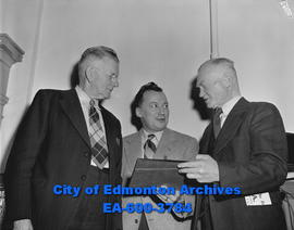 YMCA awards dinner, Waldo F. Empey receives award from Maxwell C. Dewar and Chester Gainer.