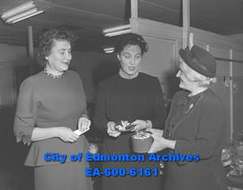 Women's Society of Museum and Arts tea and handicraft sale. (L-R) Mrs. E.W.S. Kane, Mrs. R.M. Din...