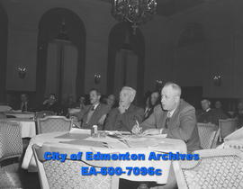 Lethbridge's city manager, A.L.H. Somerville (at right, with pen) outlines that city's contributi...
