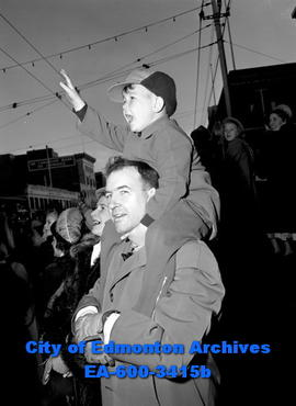 Santa parade: Cameron McAlpine watches from dads shoulders.