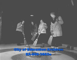 Ladies' Curling Association. Sweeping home from L-R: Mrs. H.W. Dyer, Mrs. R. Powers, Mrs. C. Whit...