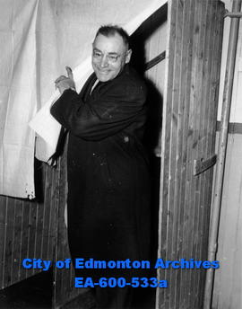 Edmonton area elections: police sergeant Y. C. Neilson, first voter at the IOOF hall.