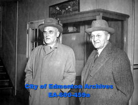Cabinet minister Rt. Hon. C. D. Howe (left) stops briefly in Edmonton on his way to coast.