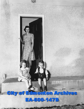 Mrs. J. D. Campbell and her children Barbara and Bruce at housing for University of Alberta profe...