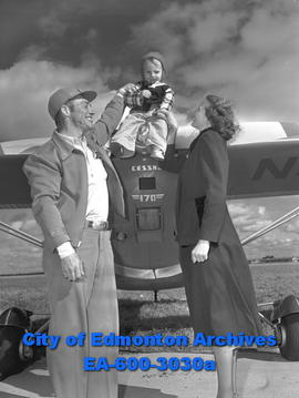 """Cloud-Pounding Cowboys Here"". Flying farmer Woody Leinenger with wife and son Billy."