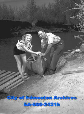"Women's Page - ""Cottage Owners Flock to Country . . .""Fred and Mary Astle canoeing."