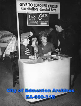 (L-R) Mrs. F. E. Dynes, Mrs. Harry Holmes and Mrs. C. A. Collins at the Northern Alberta Cancer Society booth at the Hudson's Bay Company Store.