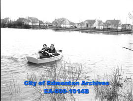 "Youngsters boating on Edmonton's west end ""lake"" at 109 street and 111 avenue: Dean Sau..."