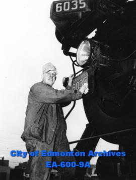 Linford S. Bell , senior CNR engineer, polishing locomotive number plate.
