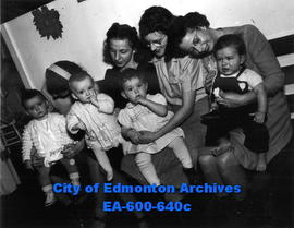 Edmonton baby clinic operated by the city board of health. (L-R) Mrs. G. H. Baldwin and Judith, M...