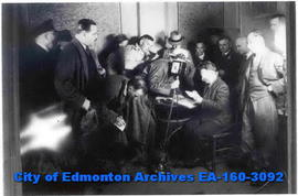 Wiley Post opens his mail at Edmonton.