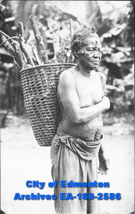 A man carrying a basket.