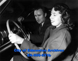 Driving instructor Arthur J. Haldin with dual-control automobile gives Edmonton Bulletin reporter...