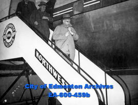 Cabinet minister Rt. Hon. C. D. Howe stops briefly in Edmonton on his way to coast. (L-R): uniden...