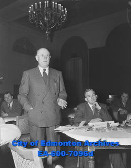 Calgary alderman A. Noel Hutchinson during a meeting of the Edmonton Chamber of Commerce, members...