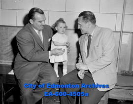 "Bulletin Baby Contest: ""Whipper"" Billy Watson and Annis Stukus with contestant."