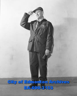 H.B. Holloway, executive of Alberta Scouts Association, wearing boy scout  winter uniform.