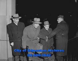 Hockey: Edmonton Flyers board train for Saskatchewan. L-R: Bing Merluk, Bernie Bathgate and Steve...