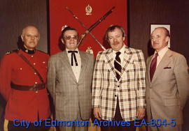 Assistant Commissioner Victor Seppala with brothers Bill Jarvis and Dick Jarvis during the City's...