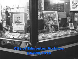 Coronet magazine display in window of newstand, Edmonton.