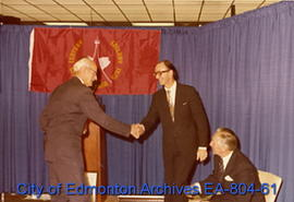 Former Lieutenant Governor and Calgary Mayor Grant MacEwan (left) shakes hands with Calgary Mayor...
