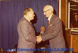 Edmonton Mayor William Hawrelak (left) shakes hands with former Lieutenant Governor and Calgary M...