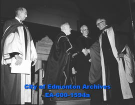 Dr. G.F. McNally, President R. Newton, honour J.A. McKinnon at the University of Alberta.