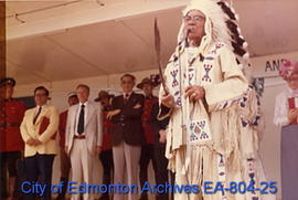 Elder Albert Lightning of Ermineskin Cree Nation at the microphone during the official ceremonies...