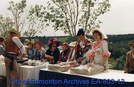 Costumed volunteers distributing food at Seniors' Klondike Picnic in the Park.