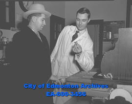 Robbery at Jewell Electric. Jack Jewell (left) and Ralph De Wolfe inspect scene.