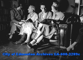 Women's Page: War vets are given books to read in hospital. L-R: Mrs. T.W. Boles, William Riste, ...