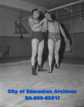 Police training begins: Constable Ron Hooper, police force wrestling expert, demonstrates grip on...