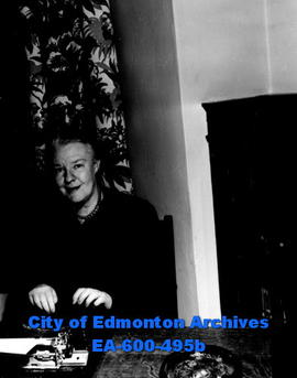Dorothy Thompson, tri-weekly newspaper columnist, with her typewriter while visiting Edmonton.