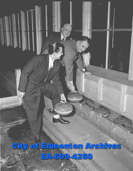 Edmonton Curling Club members Bill Watson, Don Butt and George Laight put rocks away for another ...