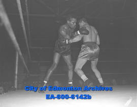 Boxers Georgie Dunn and Rudy Zadell fight at Sales Pavilion.