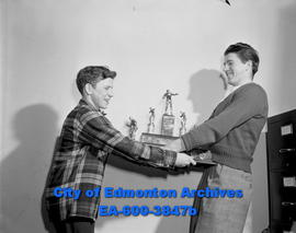 Buddy McDonald (left) and Dave Martin jostle for Golden Gloves trophy.