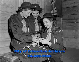 Girl Guide meeting. L-R: Ruth Shaw, Donna McCalla and Gwendolyn Sanford tie knots.