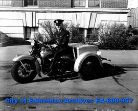 "Edmonton police force's new ""Servi-car"" tricycle motorbike ridden by Sergeant A. E. Woo..."