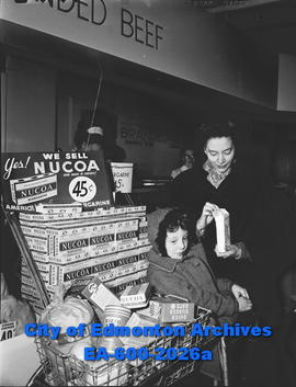 Margarine goes on sale: Mrs. A. McKinnon with daughter Donna at supermarket.