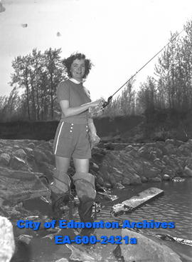 "Women's Page - ""Cottage Owners Flock to Country . . ."" Louise Porter fishing."